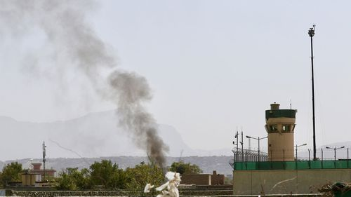 Smoke billows from the scene after six rockets were fired near Kabul airport (EPA/HEDAYATULLAH AMID).