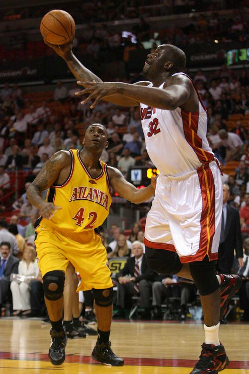 Lorenzen Wright, seen here playing against Shaquille O'Neal, was murdered nine years ago.