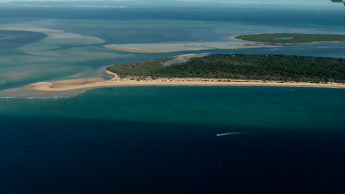 The pair took on water after travelling through dangerous conditions near north Stradbroke Island.