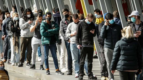 People queuing up at the Melbourne Exhibition Centre vaccine hub yesterday.