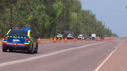 Police scoured bushland for evidence after a passerby found the woman's body.