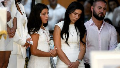 Leila Geagea Abdallah (middle) and daughter (left) are seen during the funeral for her children Antony Abdallah, 13, Angelina Abdallah, 12, and Sienna Abdallah, 8, at Our Lady of Lebanon Co-Cathedral in Sydney