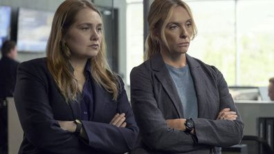 "This image released by Netflix shows Merritt Wever, left, and Toni Collette in the true crime series ""Unbelievable."""