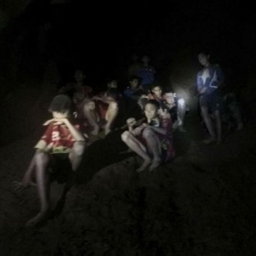 """The moment the Thai boys were found by rescuers, their first words to their British saviours, """"we're hungry!"""" Picture: Supplied"""