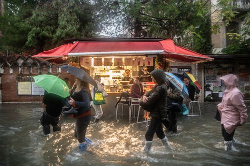 Residents and businesses typically reinforce their doors with metal or wooden panels to prevent flooding. But photos show shop owners using water pumps to protect their wares.