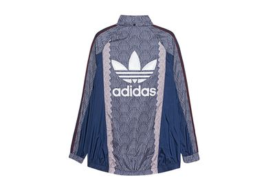 "<a href=""http://www.jades24.com/en/product/women/clothing_woman/jackets_coats_woman/adidas-d-trainingsjacke-shell-wb_mlt/index.html?"" target=""_blank"">Windbreaker (shown from back), $147, Adidas Originals at Jades24.com</a>"