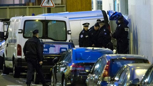 Police officers remove the bodies of slain Charlie Hebdo magazine staff members, including the chief editor and a number of cartoonists. (AAP)