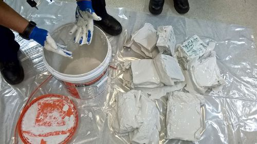 A supplied image obtained on October 6, 2017 of 350 kilograms of methamphetamine's hidden inside buckets of plaster. Authorities have seized the biggest haul of methamphetamine precursor chemicals in Australian history with a potential street value of $3.6 billion. (AAP)