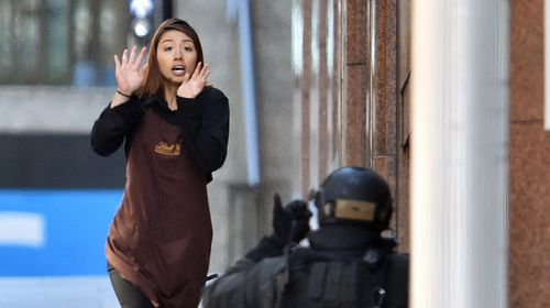 She was one of five hostages to escape with at least 10 more feared inside the Martin Place shop. (Getty)