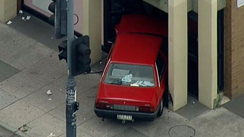 The driver crashed into the Westpac Bank branch after colliding with another car. (9NEWS)