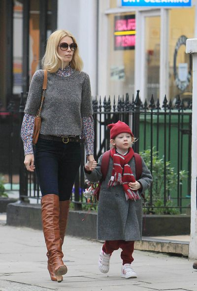Supermodel Claudia Schiffer doesn't miss a style step with knee-high boots and oversized sunnies, while walking daughter Clementine to school in London, 2011.