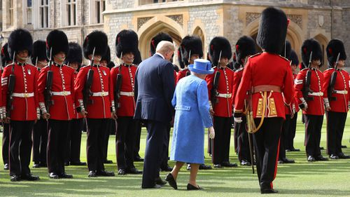"""""""The Star-Spangled Banner"""" was then played and the queen guided the president on a review of the honour guard in the castle courtyard. Picture: AP"""