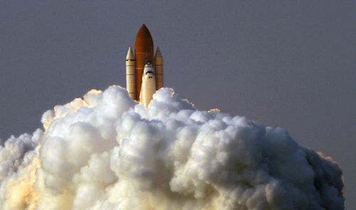 The photojournalist captured many iconic moments during his years at AP, including the space shuttle Endeavour lifting off from the Kennedy Space Center in 2007. Picture: Alan Diaz / AP