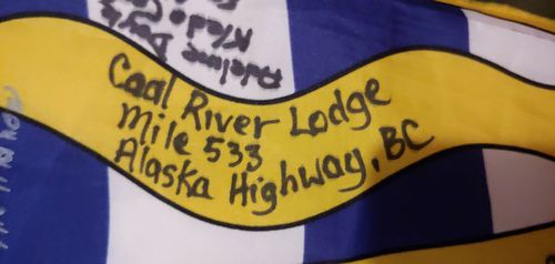 Many road house lodges on the remote Alaska Highway, a highway to reach Alaska through BC, have signed the flag.