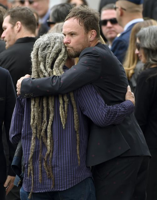 Jeff Ament, pictured hugging a guest at a funeral for Soundgarden's Chris Cornell in Los Angeles in May, is unapologetic about the poster.