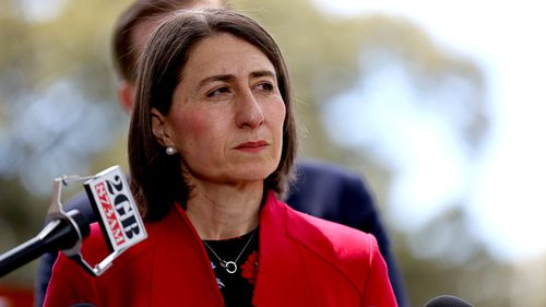 """Gladys Berejiklian should be """"judged on her record rather than being hit by brand damage"""" Mr Turnbull said."""