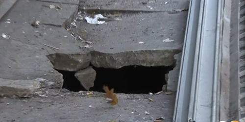 Witnesses in the Bronx, New York, say a man fell into a hole after the sidewalk he was standing on suddenly gave way.