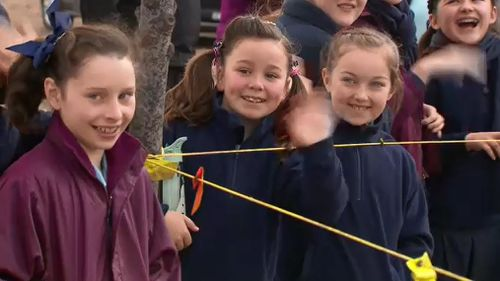 Children from local schools cheered as the much-needed hay was brought to their town.