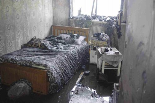A bedroom in flat 16 where the fire started in the kitchen. (AAP)