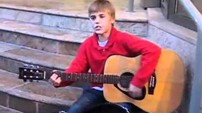 Justin Bieber aged 12 singing outside Avon Theatre