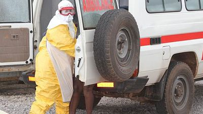 She wore full protection gear while helping patients with Ebola. (AAP)