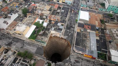 This intersection in downtown Guatemala City was swallowed by a sinkhole in May 2010. (AAP)
