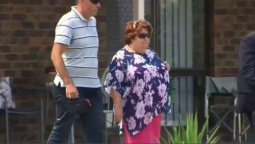 The mother of accused gunman Brenton Tarrant can be seen leaving a property following the raids.