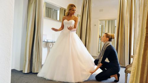Would-be newlywed Zoe tests out her gown. (Nine Network)