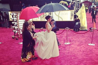 @sideofginger: Giuliana Rancic and her cupcake dress are being carried onto the red carpet. #oscars