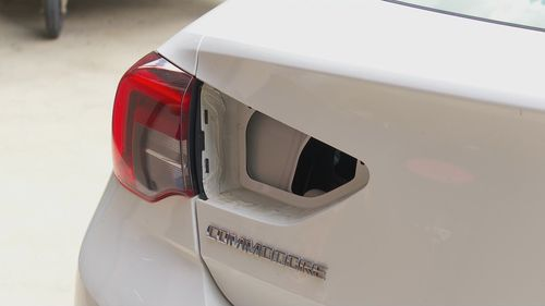 A driver saw a woman's hand protruding out of this tail light before he called police.