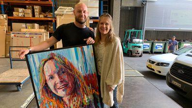 Joe Lander and subject Jennie Hudson deliver his Archibald Prize entry.