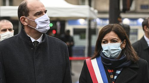 French Prime Minister Jean Castex, left, and Paris Mayor Anne Hidalgo participate in a wreath laying ceremony, marking the 5th anniversary of the Nov. 13, 2015 attacks outside the Bataclan concert hall in Paris, Friday, Nov. 13, 2020