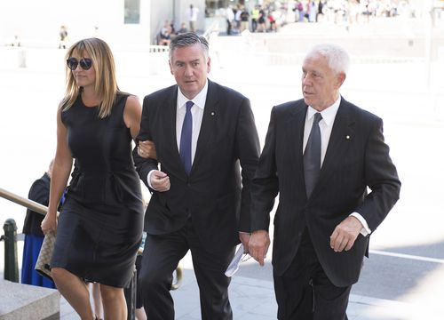 Carla McGuire (left) and Eddie McGuire (middle) arrive for the state funeral service for Ron Walker, former F1 Australia Grand Prix boss and a former Melbourne Lord Mayor. (AAP)