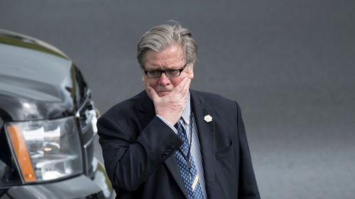 Steve Bannon waits as US President Donald Trump arrives at Lynchburg Regional Airport in Lynchburg, Virginia on May 13, 2017. (AFP)