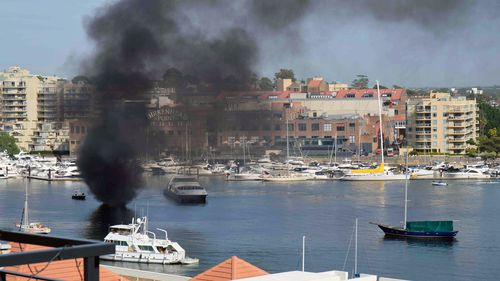 The boat caught fire near the Birkenhead Point shopping outlet.