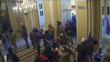A security video showing rioters entering the Capitol.