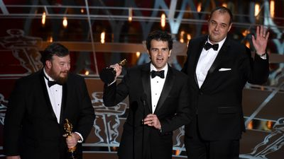 <b>Best Sound Mixing:</b><br><br>Thomas Curley, Craig Mann and Ben Wilkins collect their Oscars for their work on 'Whiplash'. (AAP)