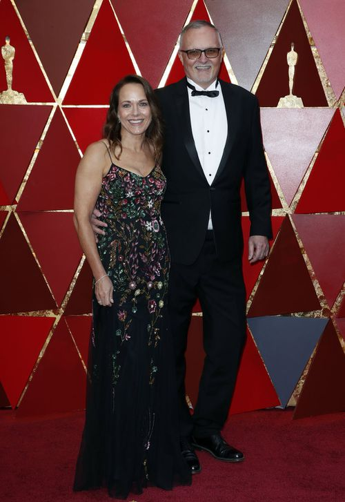 Lee Smith and wife Kimberly arrive at the Dolby Theatre. (AAP)