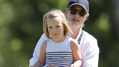 Mia Tindall with Zara Phillips at a charity golf tournament, July 2018