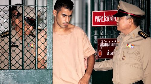Soccer player with Australian refugee status Hakeem Al-Araibi is escorted to his court hearing by Thai prison officers.