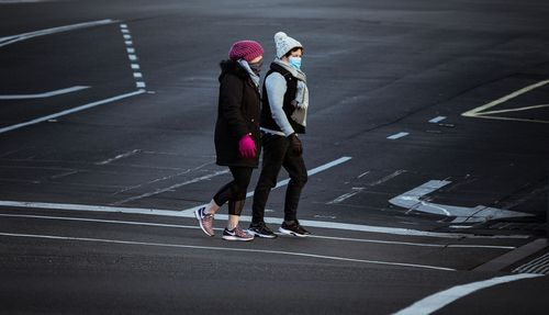 Woman wearing masks walk along Sturt Street in Ballarat on August 21, 2020 in Ballarat, Australia.
