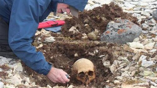 A researcher excavating an unidentified body from the doomed Franklin expedition.