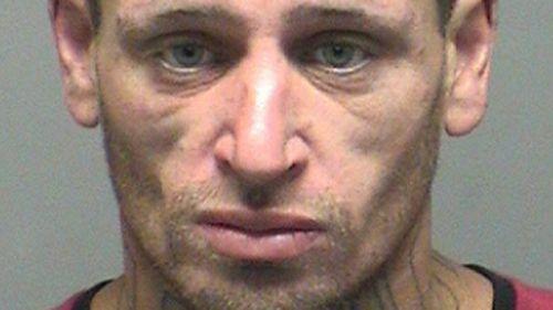 Violent prison escapee with 'thug' neck tattoo captured in Hobart bushland