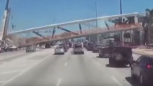 Dashcam footage captured the moment the newly-installed bridge collapsed on a six-lane road in Miami. (Youtube / OfficialJoelF)