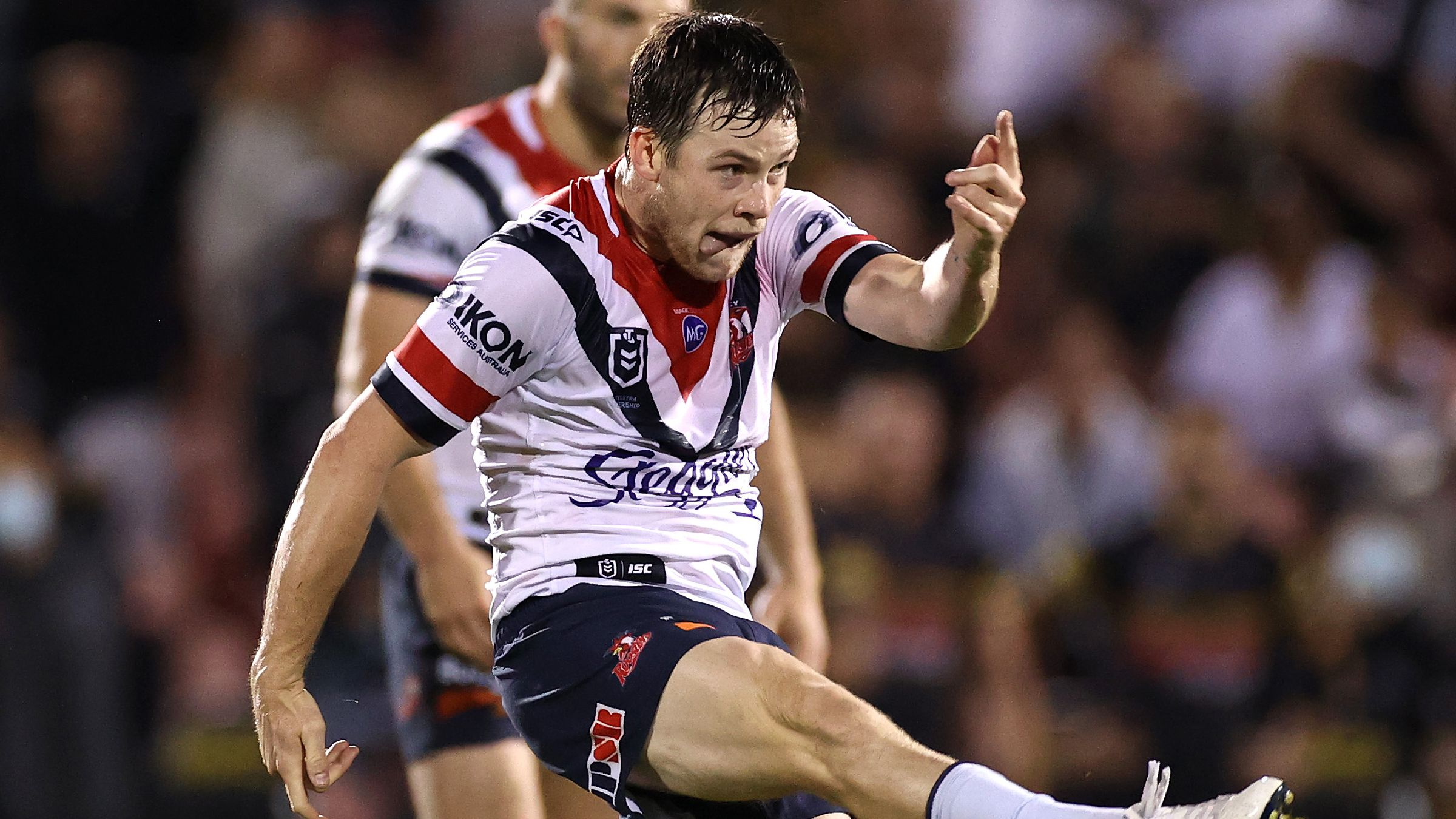 Roosters star Luke Keary attempts a field-goal.