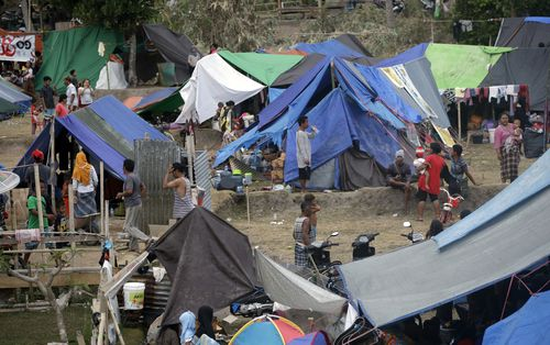 The figures come as government aid assistance has increased for the island of Lombok, where people have resorted to living in tents. Picture: AAP.