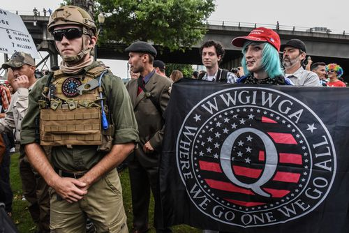 """The baseless QAnon conspiracy theory began in October 2017 when a person or persons using the name """"Q"""" (which is a level of US security clearance) posted a thread on 4chan, an anonymous American messaging board regarded as the birthplace of the alt-right movement. The theory quickly moved from the darkest corners of the internet to draw in people around the world."""