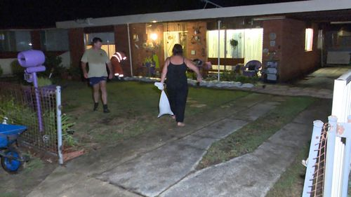 'Like a swimming pool in my backyard': Sydney residents clean up after floodwater inundates homes and shops