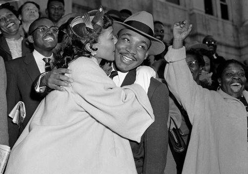 Rev. Martin Luther King Jr. is welcomed with a kiss by his wife, Coretta, after leaving court in Montgomery, Alabama, in 1956.