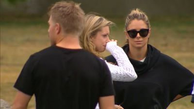 David Warner, Krista Thomas and Candice Falzon comfort one another, as friend Phillip Hughes fights for life. (9NEWS)